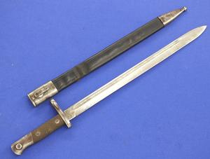 A very nice antique Spanish Bayonet Model 1913, length 55 cm, signed ARTILLERIA NATIONAL TOLEDO, Price 125 euro