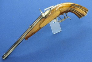 A fine antique 19th century Flobert Target Pistol, caliber 6 mm rimfire, length 43 cm, in near mint condition. Price 850 euro