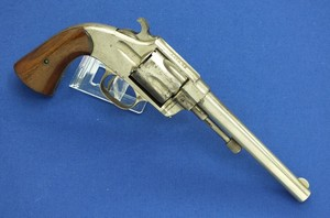 A rare antique Nickel plated American Hopkins and Allen XL Navy 6 shot single action 38 rimfire revolver with 6,5 inch barrel. In very good condition. Price 2.650 euro