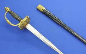 A very nice Antique French Small Sword, circa 1750, colichmarde blade, original fire-gilded hilt with silver wire, length 98 cm, in mint condition.