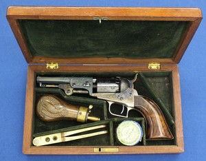 An excellent antique American cased factory engraved Colt Baby Dragoon with rammer 5 shot perkussion revolver. 31 caliber with 4 inch barrel with 2 line New york address. In mint condition.